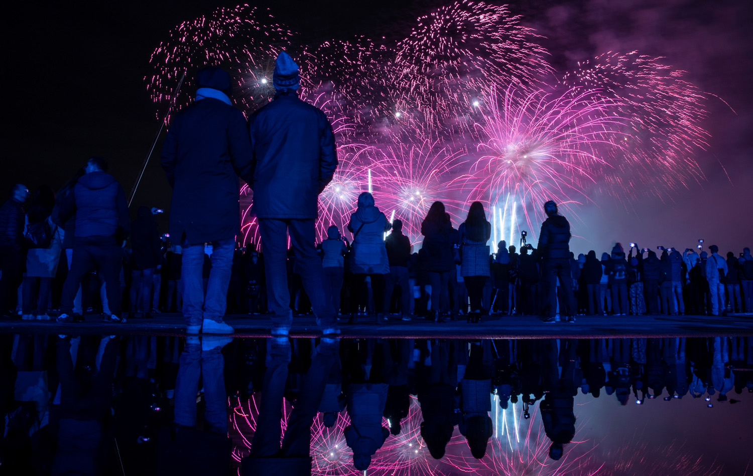 Spectators watch fireworks at the International show Circle of Light in Moscow
