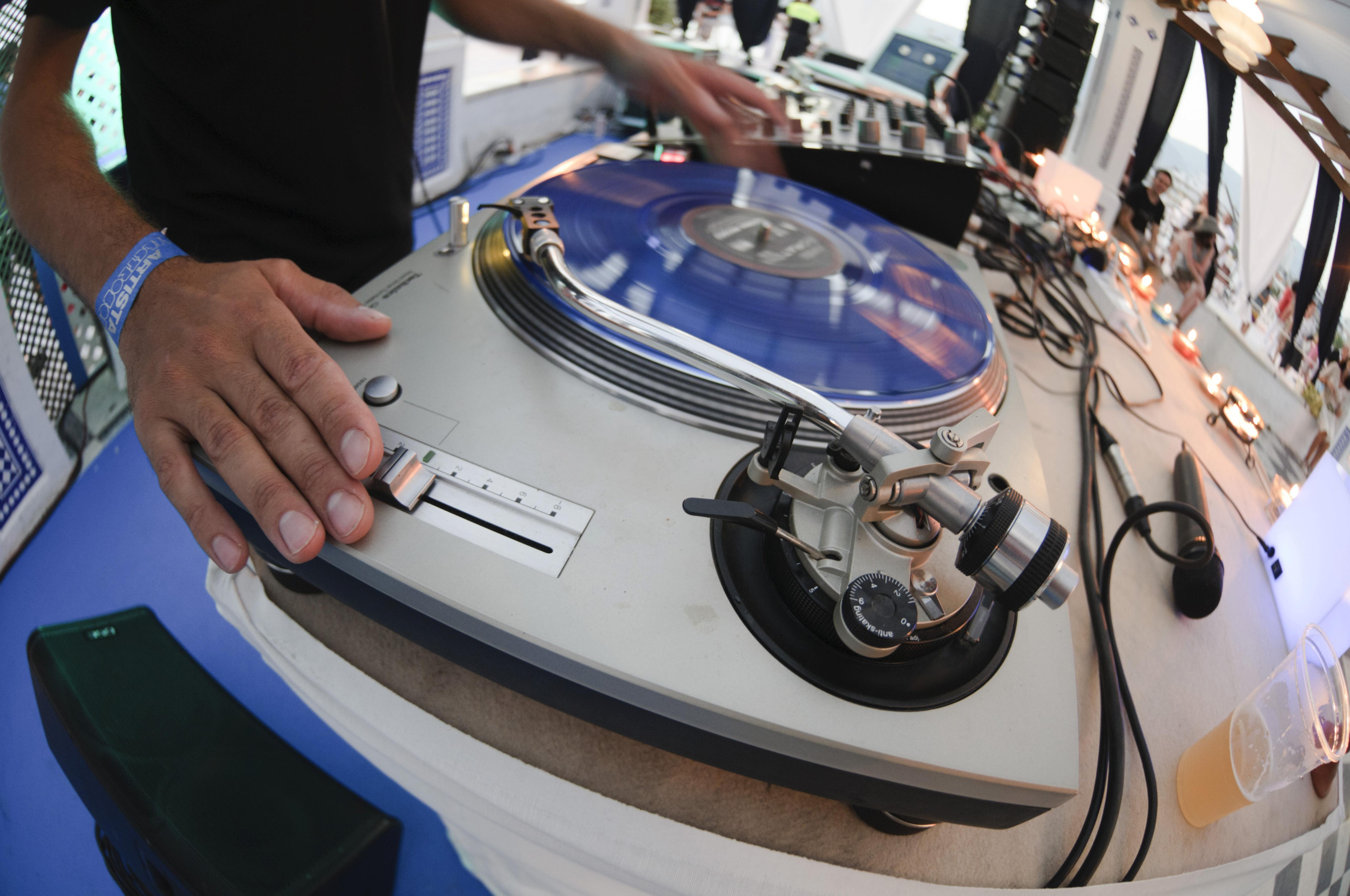 DJ using a blue scratch disc on a turntable during the Electrobeach Festival at Benidorm, Spain, Europe — iblmkb01864590.jpg